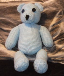 A garter stitch knit bear