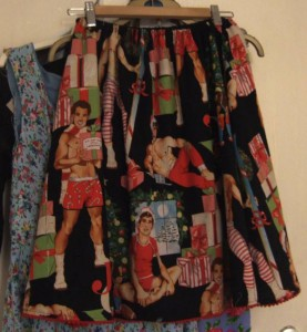 a christmas themed mini red pom pom trimmed skirt for the bestie using Alexander Henry's All I want for Christmas fabric and a black cotton lining